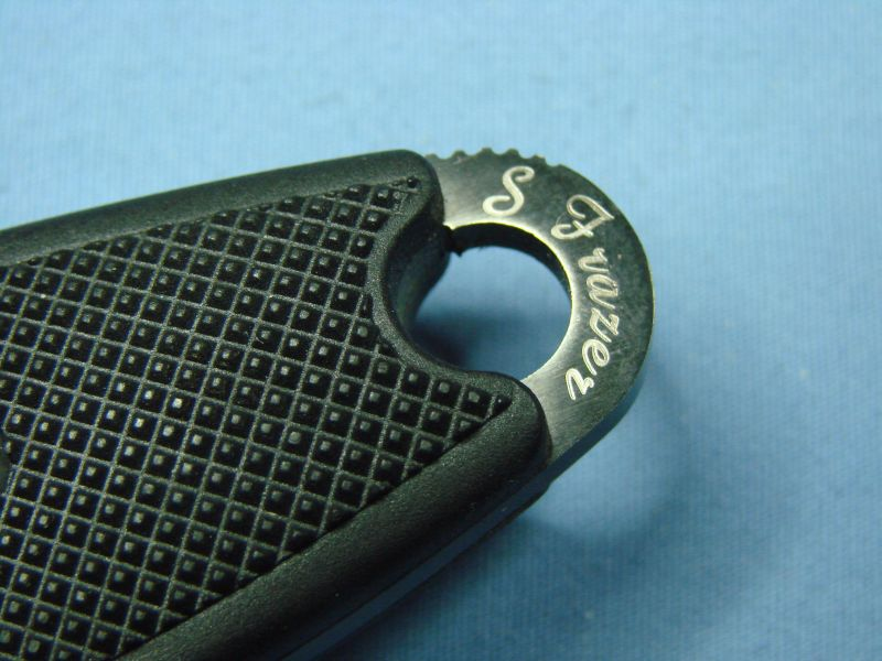 "Sog Recondo Black TiNi Spencer Frazer's engraving (Photo:""appels"" - bladeforums)"
